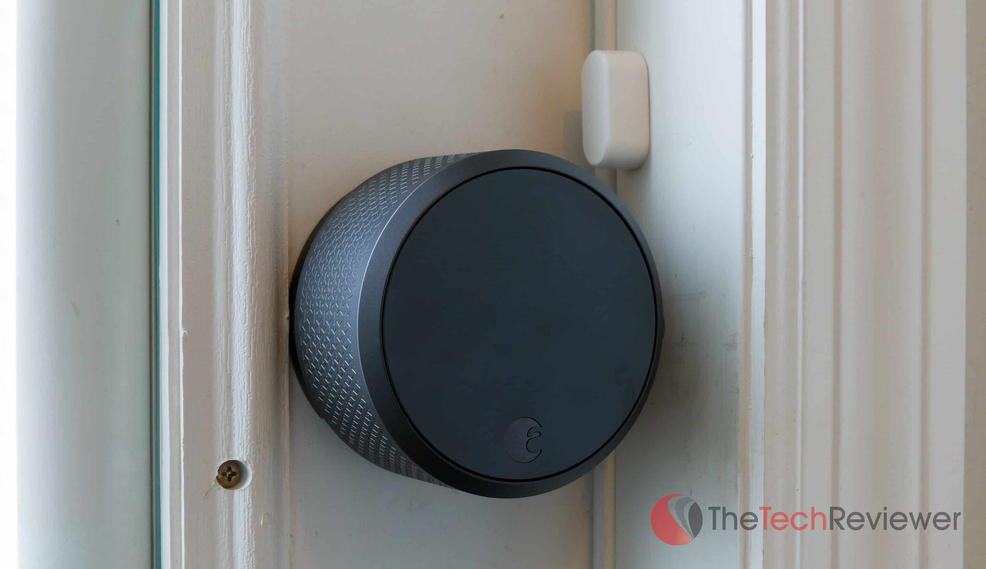 August Smart Lock Pro and DoorSense sensor close up